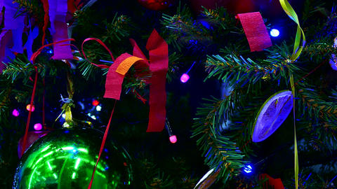 4K Christmas Tree With Decorative Balls and Paper Tape Flashing Colorful Lights Footage