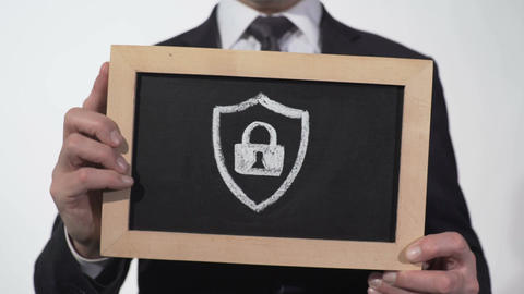 Security padlock icon drawn on blackboard in businessman hands, antivirus safety Footage