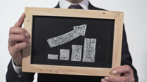 Growth up arrow graphic drawn on blackboard in businessman hands, company report Footage