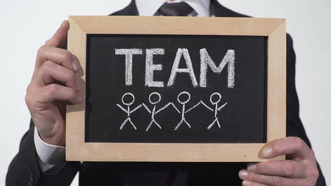 Team members drawn on blackboard in businessman hands, cooperation on project Footage