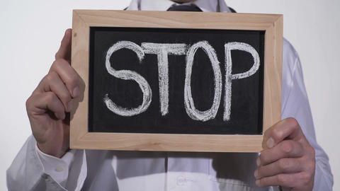 Stop written on blackboard in doctor hands, fight against harmful bad habits Live Action