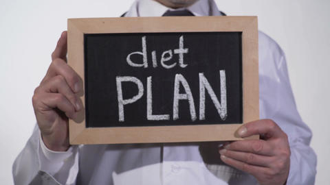 Diet plan written on blackboard in nutritionist hands, weight loss tips, obesity Footage