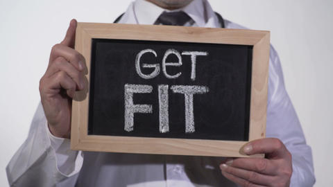 Get fit written on blackboard in doctor hands, active healthy life promotion Footage