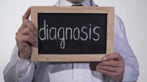 Diagnosis written on blackboard in therapist hands, diagnostic medicine services Footage