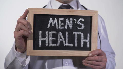 Mens health written on blackboard in urology doctor hands, reproductive medicine Footage
