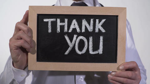 Thank you text on blackboard in therapist hands, clinic services presentation Footage