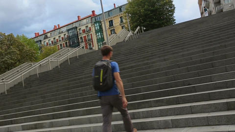 Athletic student running up granitic stairs, late for class at university Footage