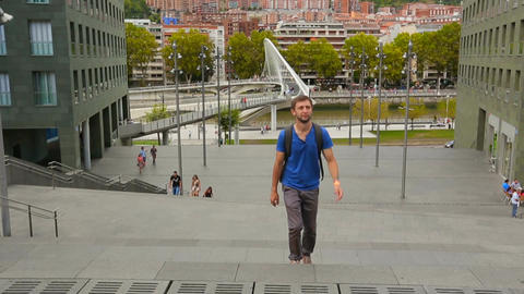 Young male tourist walking, viewing places of interest in Bilbao city center Live Action