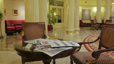 Casually dressed businessman reading local news in hotel lobby, business trip Footage