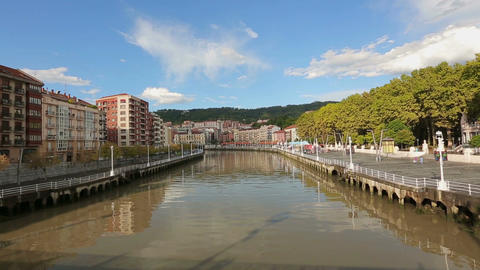 Dark water surface of Nervion river, beautiful cityscape in Bilbao, Spain Footage