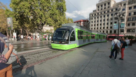 Modern tram car arriving at city square, public transportation in Bilbao, Spain Footage