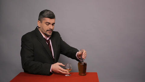 Displeased man smelling, tasting cheap scotch, dissatisfied guest in restaurant Live Action