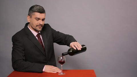 Male winemaker enjoying perfect taste of red wine, family business, sommelier Footage