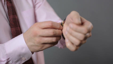 Male hands taking off expensive mechanical wrist watch, businessman undressing Footage
