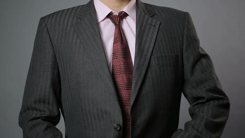 Relaxed office worker taking black jacket off after hard working day, closeup Footage