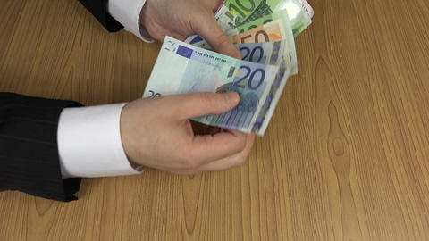 Household man count euro cash money banknotes on table. 4K Footage
