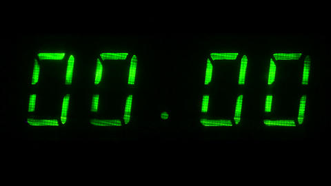 Digital clock with fluorescent display shows 00:00 in green color