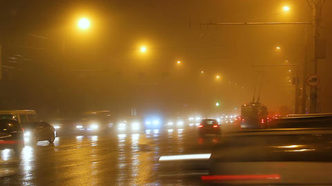 Street lights of city in fog and cars on way Footage