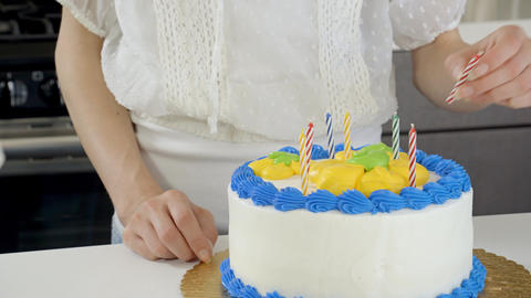 Attractive Woman Preparing A Birthday Cake Footage