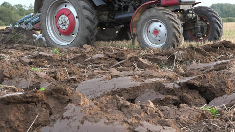 tractor till plow turn up field soil in farm arable field. Follow. 4K Live Action