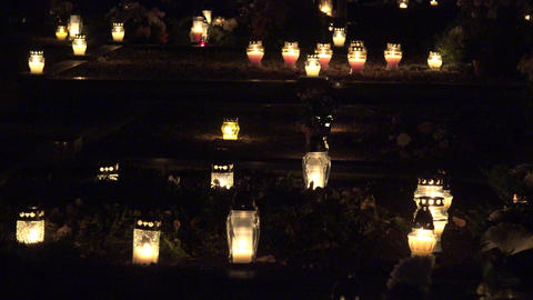 Cemetery at night with colorful candles for All Saints Day. 4K Footage