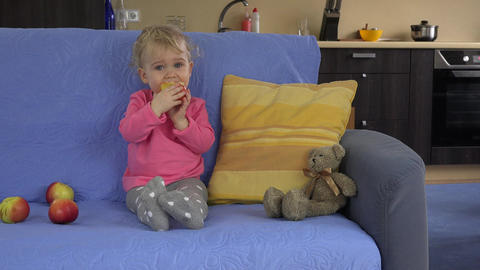 girl eat red fresh apple sit sofa. healthy lifestyle,... Stock Video Footage