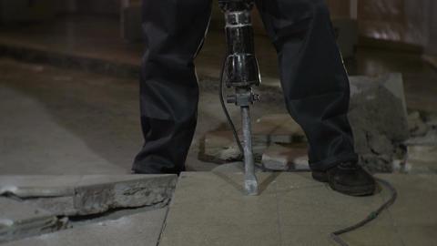 Skilled Worker Crashes Ceramic Tiles with Jackhammer Footage