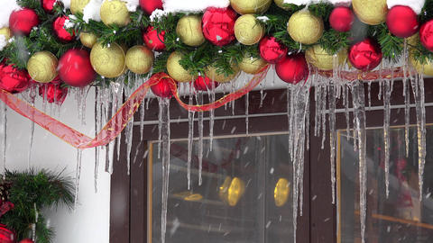 Christmas toy decorations covered with icicle and snow. Blizzard snow falling Footage