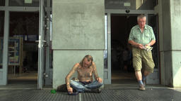 Authentic emotion senior man homeless in city begging and dog Footage