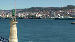 Spain Galicia City of Vigo 046 water and cityscape behind lighthouse Footage