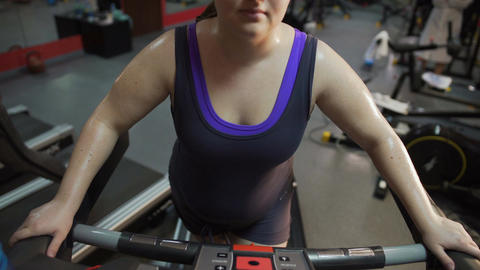 Hardworking obese lady working hard in gym, aspiring to be slim and healthy Footage