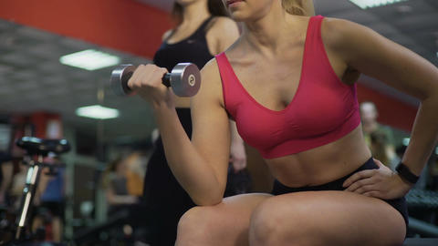 Woman with perfect fit body doing dumbbell exercises in gym, active lifestyle Footage