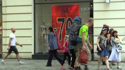 A homeless man drunk in a luxury street, tourists, shop window, street life Footage