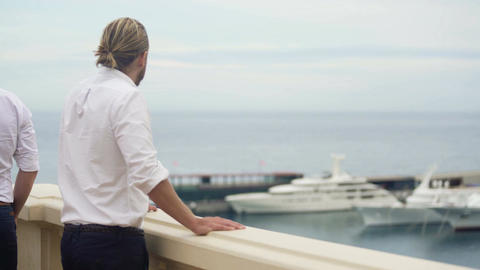 Wealthy billionaire looking at expensive yacht, luxury lifestyle of rich man Footage