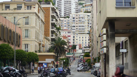 Street in Monaco, busy people walking, transport passing by, European city life Live Action