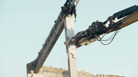 High-rise demolition tool of excavator crashing huge concrete construction Footage