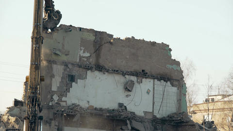 Demolition tool pulling down high wall, removing obstacle, breaking regime Footage