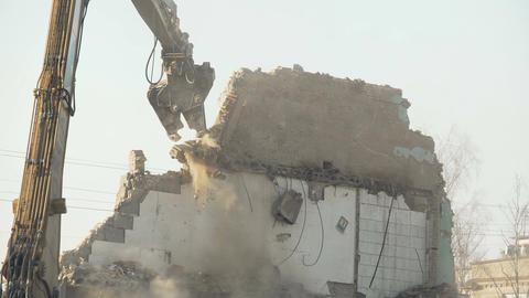 Strong demolition tool crashing old wall, breaking rules, fighting stereotypes Footage