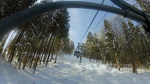 Mountain chairlift carrying people to ski track, active winter rest, tourism Footage