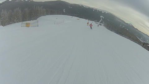 People enjoying extreme sports hobby, go skiing and snowboarding in mountains Footage