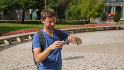 Male traveller taking panorama picture of cityscape on gadget, summer vacation Footage