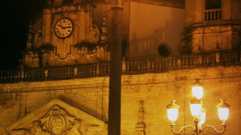 Mysterious haunted royal palace lit by yellow street lamps at night, history Footage