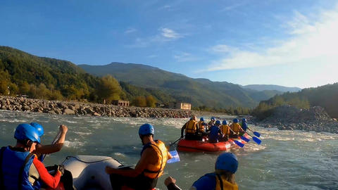 Experienced rafting teams descending river rapids on boats, extreme sports Footage