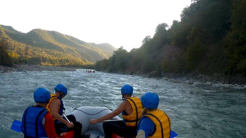 Team of experienced athletes sailing down the river on rafting boats, expedition Footage