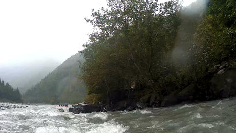 Fast mountain river carrying danger and obstacles for inexperienced rafters Footage