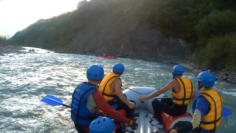 Rafting crews keeping balance in boats, sailing down the mountain river Footage