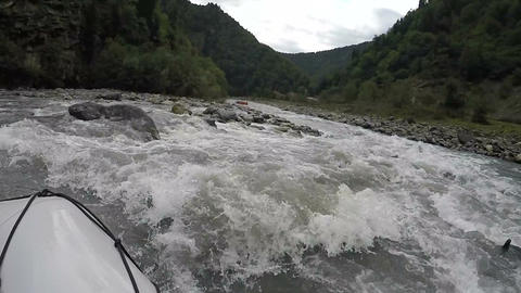 Experienced rafters bypassing obstacles of mountain river on way to victory Footage