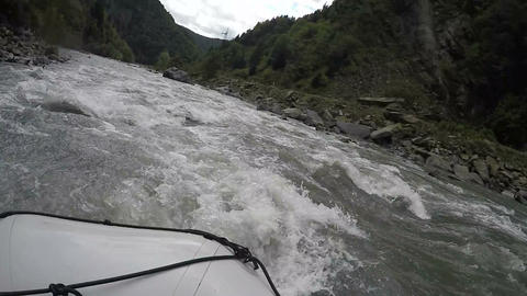 Rescuers rushing through troubled wild river to save rafting team in trouble Footage