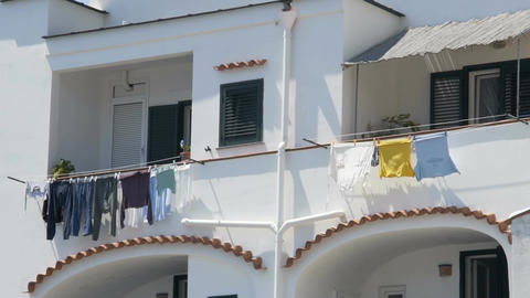 Balconies of neighboring apartments at residential house, laundry drying in wind Footage