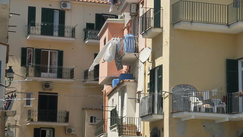 Sunny mediterranean town, ordinary residential district, laundry on balconies Footage